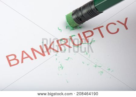 Pencil Erasing The Word 'bankruptcy' On Paper