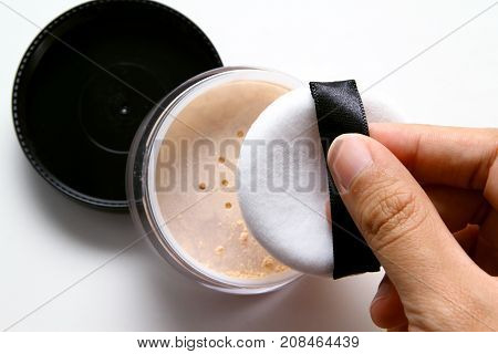 Compact powder and  brush / Cosmetics that are meant to be used on the face and eye area are usually applied with a brush, a makeup sponge, or the fingertips