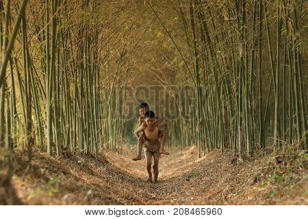 Asian childrens playing in the forest at countryside.