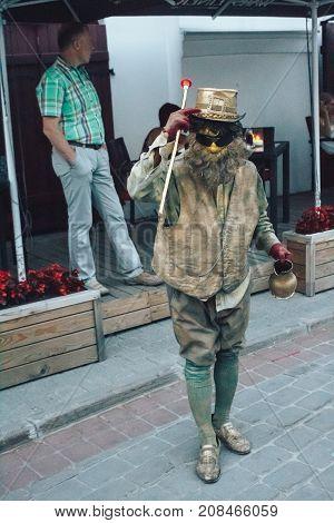 MINSK BELARUS.August 12 2017. Street Theater Man in the form of a statue