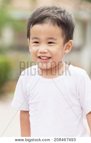 portrait head shot of asian children toothy smiling face happiness emotion