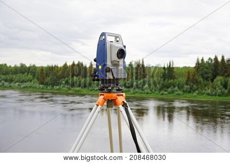 Modern electronic tachymeter mounted on tripod in field condition