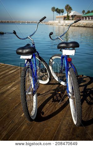 Romantic get away. Two bikes on a pier.