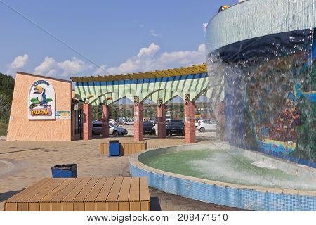 Anapa, Krasnodar region, Russia - July 23, 2017: Waterfall with a scheme at the entrance to the water park