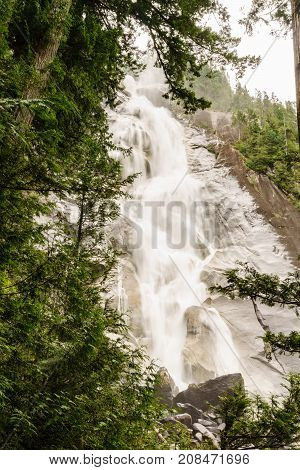Shannon Falls Near Squamish, Bc, Surrounded By Trees.