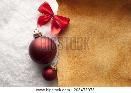 Christmas Background - Paper Sheet And Baubles On Snow