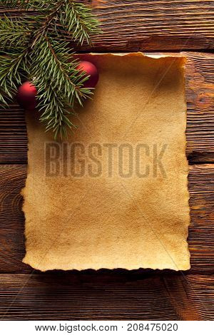 Christmas background - blank paper sheet and branch of spruce tree