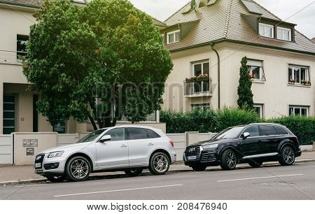 PARIS FRANCE - JUN 25 2017: Two luxury allroad Audi vehicles parked in an upper-class neighbourhood in Strasbourg France