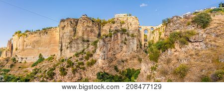 Panoramic view at the El Tajo gorge with bridge (Puente Nuevo)in Ronda - Spain