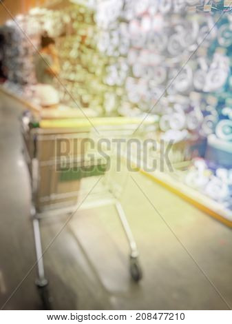 Blurred Image Of People Shopping In At Hardware Store Or Storehouse With Variety Of Indoor & Outdoor