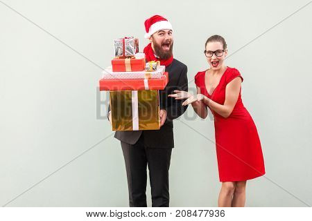 Bearded Businessman Holding Many Gift Box, Woman Shows His Hands On Box. Happiness  And Funny Well D