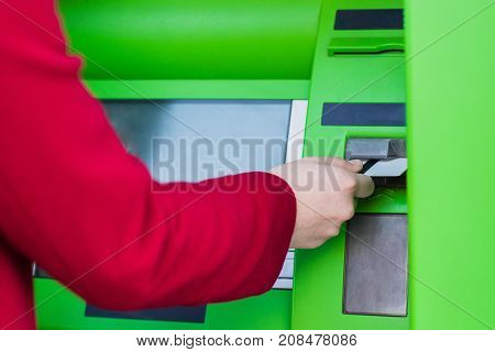 Putting Credit Card Into Atm