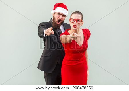 Hey You. Seriously Businessman And Woman Looking At Camera, Pointing Fingers And Alert.