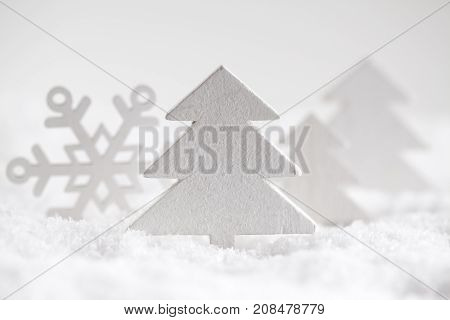 Christmas Trees And Snowflake On Snow And White Background