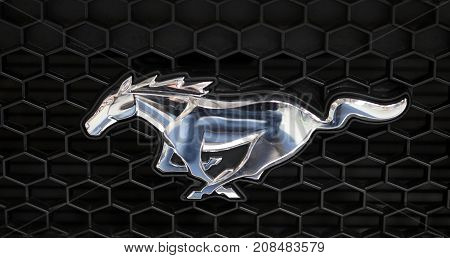 CRACOW POLAND - MAY 20 2017: Ford Mustang metallic logo closeup on Ford Mustang car displayed at MOTO SHOW in Cracow Poland. Exhibitors present most interesting aspects of the automotive industry