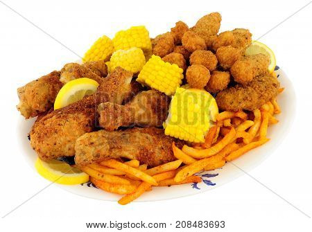 Plate of Southern fried chicken products with sweetcorn and fries