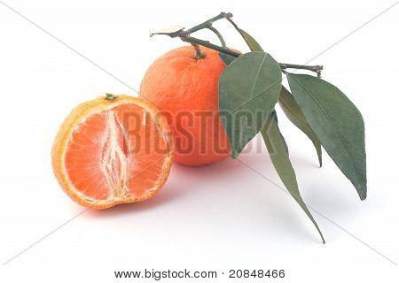 Ripe Mandarine And Leaf