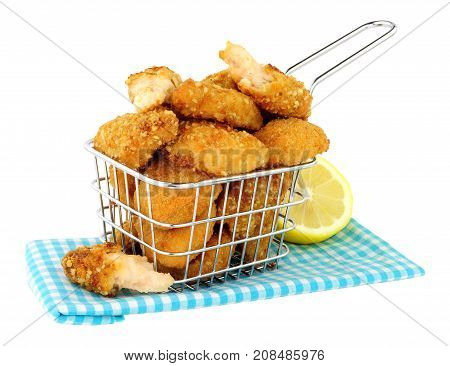 Breadcrumb fried scampi in a small wire frying basket isolated on  a white background