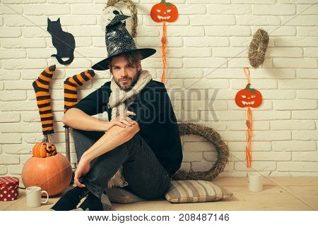 Halloween Man Sitting With Gift Box And Cups On Floor.