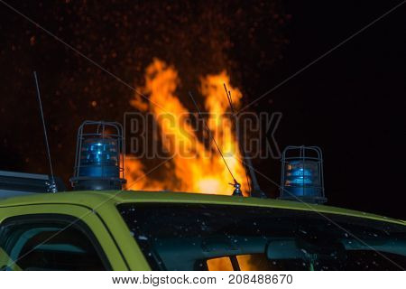 Close-up of Blue Siren on Emergency Vehicle and Fire in background