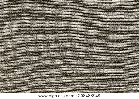 beige background of texture of knitted material or plexus fabric closeup