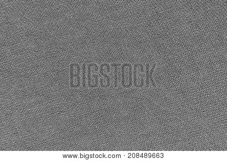 gray background of texture of knitted material or plexus fabric closeup