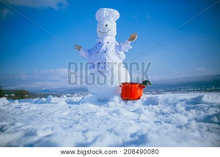 New Year Snowman Chef From Snow With Pot.