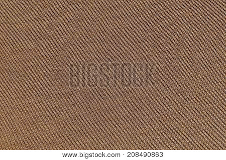 brown background of texture of knitted material or plexus fabric closeup