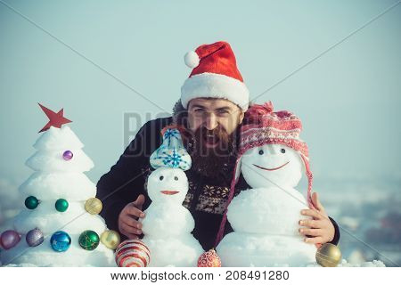 Happy Hipster In Santa Claus Cap On Winter Day