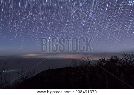 Long Exposure Image Showing Star Trails Over The Mountain