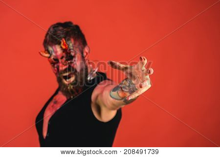 Halloween Hand Of Devil With Tattoo On Skin Stretch