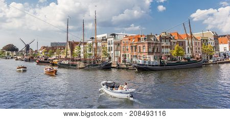 LEIDEN, NETHERLANDS - SEPTEMBER 03, 2017: Panorama of old wooden ships in the central canals of Leiden Netherlands
