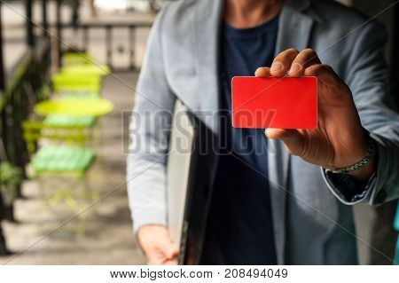 Young Busines Man Holding A Business Card
