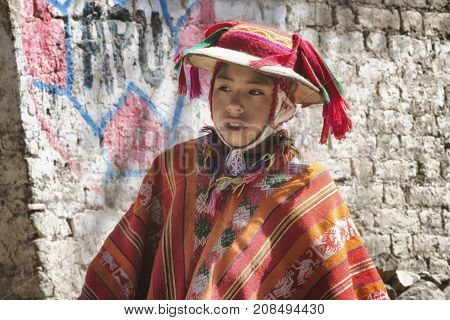 Peruvian boy dressed in colourful traditional handmade outfit. October 21 2012 - Patachancha Cuzco Peru