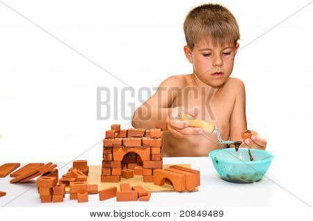 Child Build A Small House Made ??of Bricks