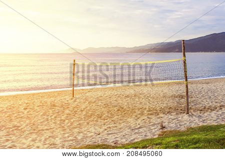 Beach volley court with sea background with burning sun