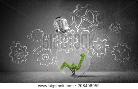 Lightbulb with growing green arrow graph inside placed against sketched gear mechanism on grey wall on background. 3D rendering.