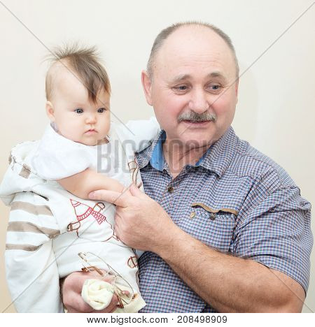 grandfather and granddaughter. Older senior and his little baby grandchild together portrait. Next generation in family