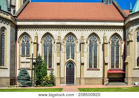 Beautiful architecture of the historic church. Facade of the parish of the Blessed Trinity in Wilamowice in Poland.