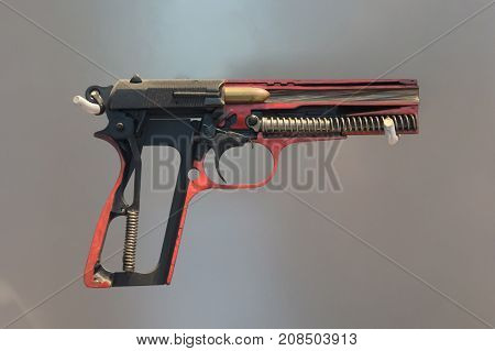 Half Metal 9Mm Pistol Gun On Solid Background