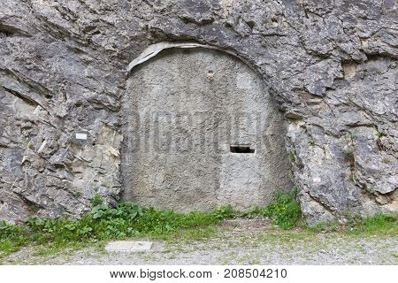 Concrete Door In A Mountain