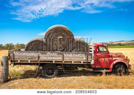 Adelaide Australia - January 16 2016: Old abandoned truck with hay near Moorooroo Park Vineyards in Barossa Valley South Australia