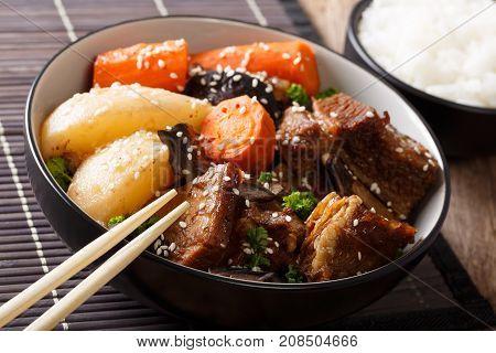 Korean Braised Beef Short Ribs With Rice Garnish Close-up. Horizontal