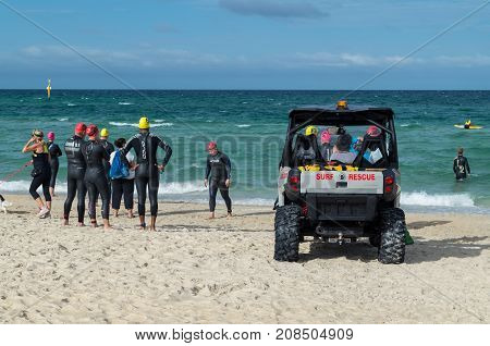 Melbourne, Australia - February 11, 2017: surf life savers from Edithvale Life Saving Club, patrolling Edithvale Beach on an off-road vehicle.