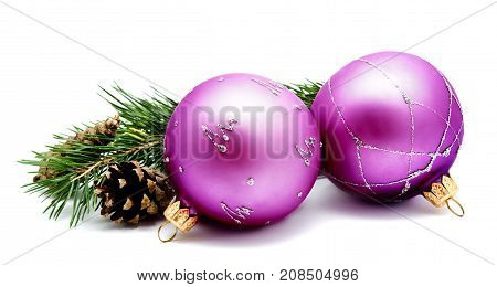Christmas decoration lilac magenta balls with fir cones and fir tree branches isolated on a white background