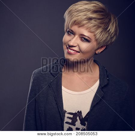 Happy Toothy Smiling Young Blond Woman With Short Bob Hair Style Looking In Grey Trendy Jacket On Da