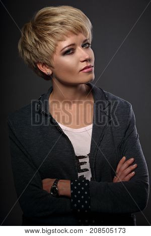 Beautiful Sexy Business Woman With Short Bob Blond Hairstyle In Fashion Jacket On Grey Background. C