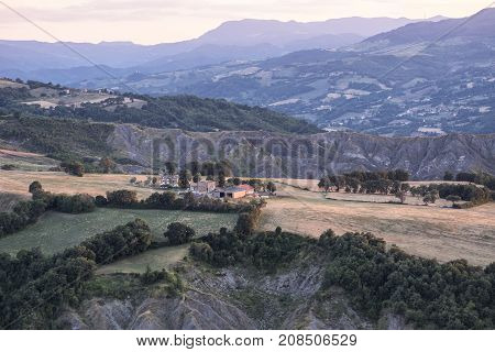 Sunset at San Leo (Forli Cesena Emilia Romagna Italy): landscape from the historic town at evening