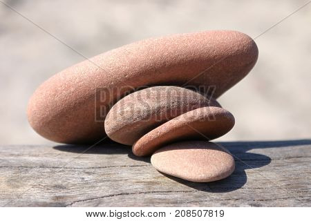 Heap of pebble stones pressing each other and collapsing close-up picture
