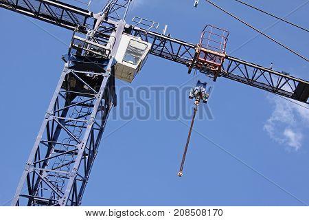 Construction crane against blue sky, low angle view